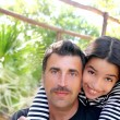 Hispanic latin father and teen daughter hug park — Stok fotoğraf