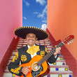 Charro Mariachi playing guitar in Mexico stairway — Stock Photo #5396923