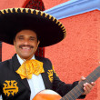 Charro Mariachi playing guitar Mexico houses — Stock Photo #5396940