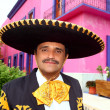 Charro mexican Mariachi portrait in pink house — Stock Photo #5397029