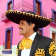 Charro mexican Mariachi portrait in pink house — Stock Photo