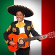 Charro Mariachi playing guitar in Mexico flag — Stock Photo