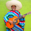 Mexican typical man playing guitar poncho — Stock Photo