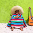 Mexican typical lazy topic man guitar poncho sit — Stock Photo