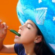 Mexican girl profile eating jalapeno hot chili pepper — Stock Photo