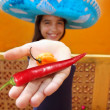Mexican girl habanero and red hot chili pepper — Stock Photo