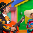mexican mariachi charro man and poncho mexico girl — Stock Photo