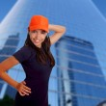 Beautiful Latin teen hispanic girl orange cap posing — Stock Photo