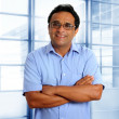 Indian latin businessman glasses blue shirt in office — Stock Photo