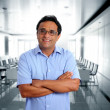 Stock Photo: Indian latin businessman glasses blue shirt in office