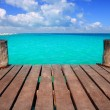 Caribbean wood pier with turquoise aqua sea — Stok fotoğraf