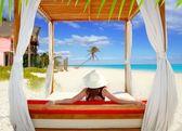 Gazebo tropical beach woman rear view looking sea — Stock Photo
