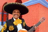 Charro Mariachi playing guitar Mexico houses — Stock Photo