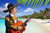 Charro mexican Mariachi playing guitar in beach — Stock Photo