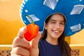Mexican girl habanero orange hot chili pepper — Stock Photo