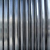 Stainless steel silver metal stripes texture rows — Stock Photo