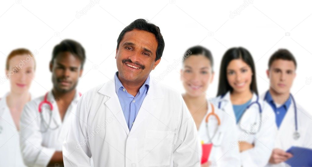 Indian latin expertise doctor multi ethnic doctors nurse in background — Stock Photo #5397883