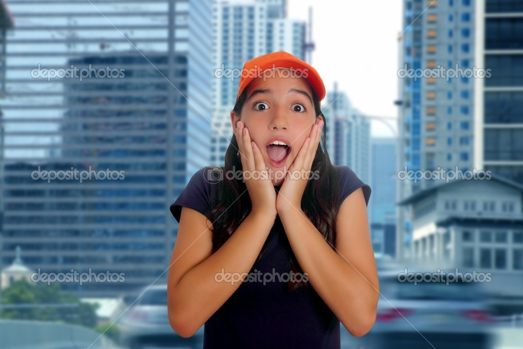 Beautiful Latin teen hispanic girl cap surprise gesture urban city street — Stock Photo #5398319