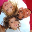 Below view of happy three children embracing — Stock Photo #5494905