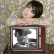 Retro woman in love with tv african hero — Stock Photo #5494911