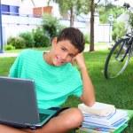 Boy teenager homework studying sitting garden — Stock Photo
