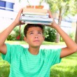 Boy teenager student holding head stacked books — Stock Photo