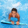 Boy teenager surfboard splashing blue water — Stock Photo #5495008