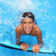 Stock Photo: Boy teenager surfboard splashing blue water