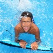 Boy teenager surfboard splashing blue water — Stock Photo