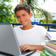 Happy teenager student boy working laptop — Stock Photo