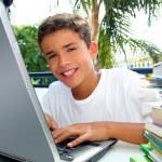 Happy teenager student boy working laptop — Stock Photo #5495035
