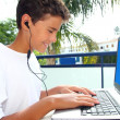 Teenager student happy boy laptop earphones — Stock Photo