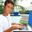 Teenager student happy boy laptop earphones - Stock Photo