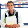 Boy student teenager backpack holding books - Stock Photo