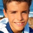 Handsome teenager boy closeup portrait smiling beach — Stock Photo