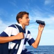 Boy teenager binoculars explorer in blue beach — Stock Photo