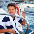 Teenager boy sea marina summer vacation in boat — Stock Photo