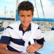 Boy teen sailorsitting on marina boat chart map — Stock Photo