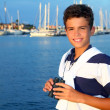 Stock Photo: Binoculars teenager boy on boat marina