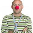 Actor clown posing clown nose and tie — Stock Photo