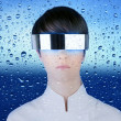 Silver futuristic glasses woman behind dropsoing glass — Stock Photo