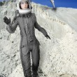 Astronaut fashion stand woman space suit helmet — Stock Photo