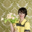 Housewife nerd retro woman ugly flowers vase — Stock Photo #5495398