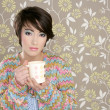 Coffee cup drinking retro fashion 60s woman - Stock Photo