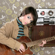 Retro woman musician guitar player vintage — Stock Photo