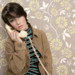 Talking telephone retro woman on vintage wallpaper — Stock Photo