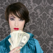 Fashion dollar woman with many notes in hand — Stock Photo