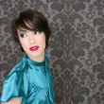 Fashion retro red lips woman on gray wallpaper — Stock Photo
