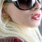 Blond fashion girl portrait red lips gray grunge background — Stock Photo
