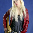 Blond sexy fashion young girl electric guitar rock star blue background — Stock Photo #5495771